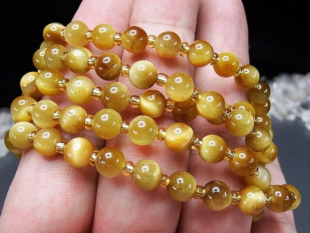 色合い良好ミルキーゴールデンタイガーアイ6.5mm天然石ブレス < 女性アクセサリー/時計の